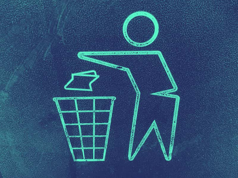 graphic of a person throwing waste into a waste basket