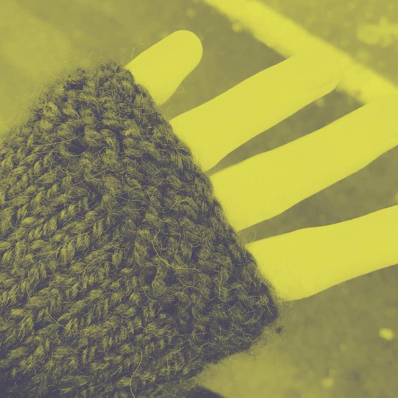 a hand in a mitten