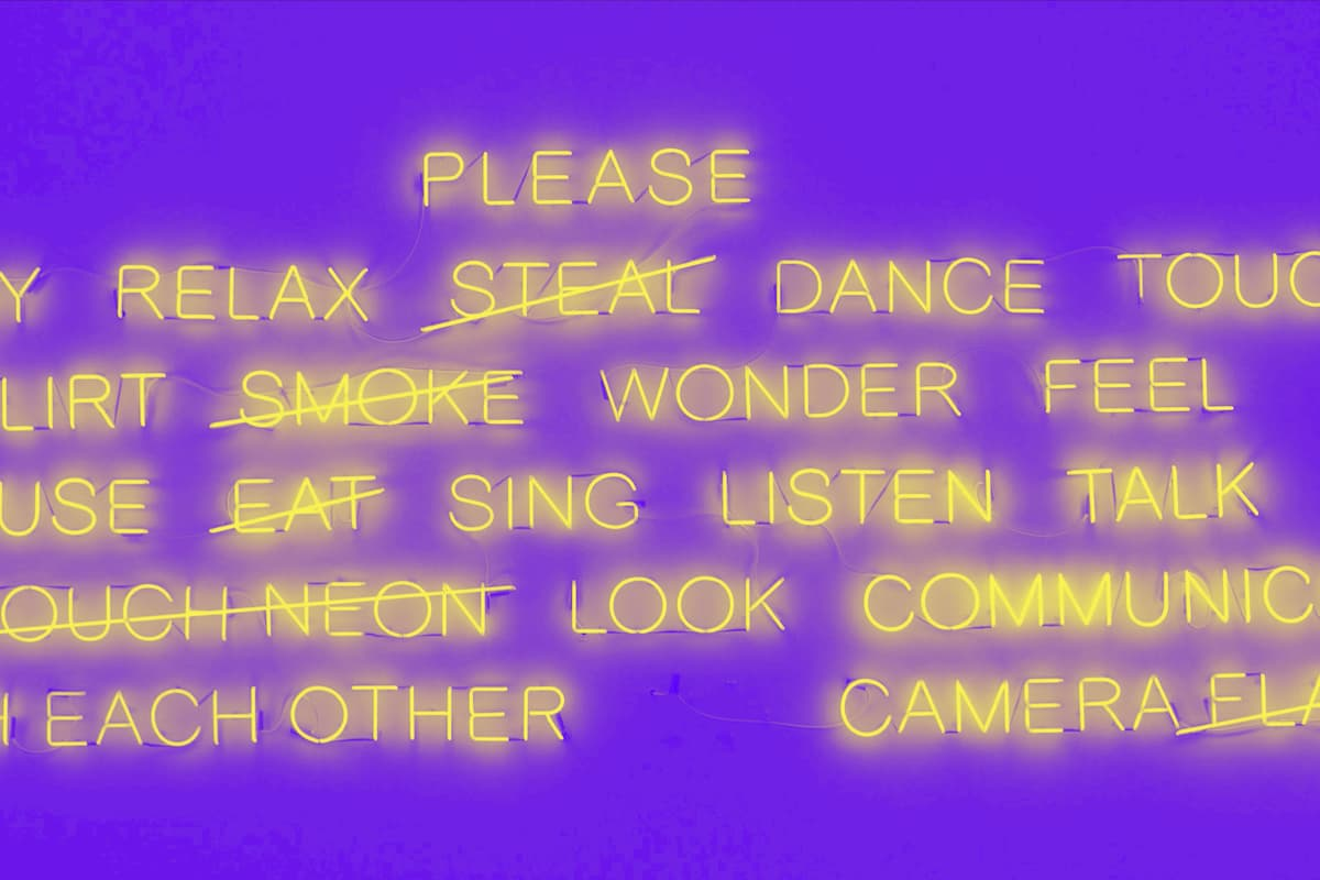 neon light words, many of which are crossed out