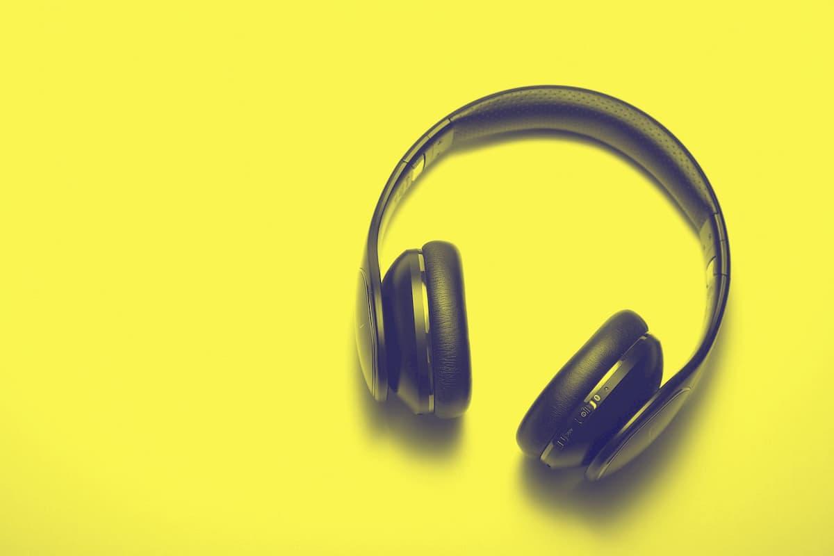 dark blue, padded headphones on yellow background